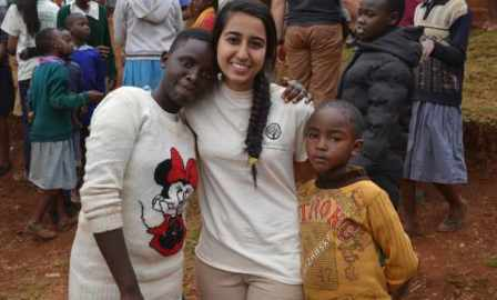 A Global Encounters participant with children at her service site. Saraan Jiwani