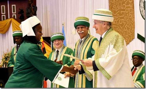 A graduand receives her degree from the Chancellor of the Aga Khan University, at the 2015 convocation ceremony in Kampala.