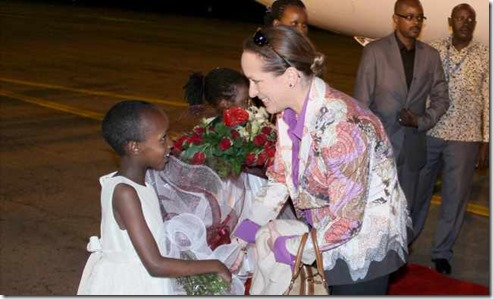 Princess Zahra is presented with flowers upon her arrival in Uganda. MOFA -Fahad Mugga