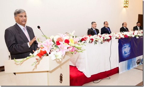 Bangladesh State Minister M.A. Mannan speaks at a gathering on public-private partnerships