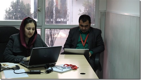 A woman sits at her desk at Roshan. Over 17% of the Afghan telecom company's managers are women,