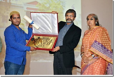 The citation being presented at the award ceremony in the city on Saturday. Anuradha Reddy (right) of Intach looks on.