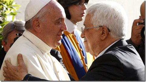 Pope Francis welcomes Palestinian President Mahmoud Abbas (R) upon his arrival at the Vatican June 8, 2014.