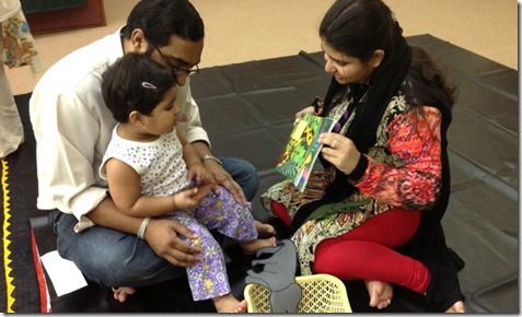 Parents play with their child during a Parwaaz early child development session. Ismaili Council for Pakistan