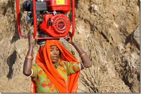 The women of the mountain villages in Rajasthan, India, carry 70 lbs