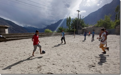 Boys play soccer on the grounds at F.G. Boys Model High School in Karimabad,