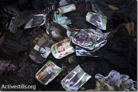 Relatives laid dozens of photos of 18-month-old Ali Saad Dawabshe in memorial to the slain toddler, Duma, West Bank,