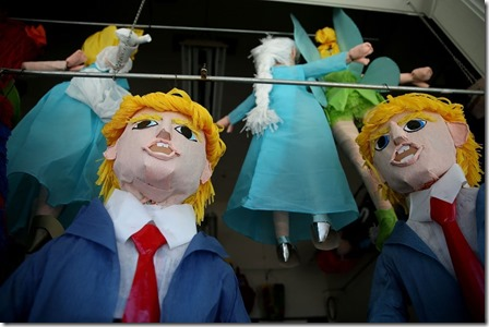 Poking fun at the über-oligarch -Donald Trump pinatas are displayed in the window of a store in San Francisco's Mission District.