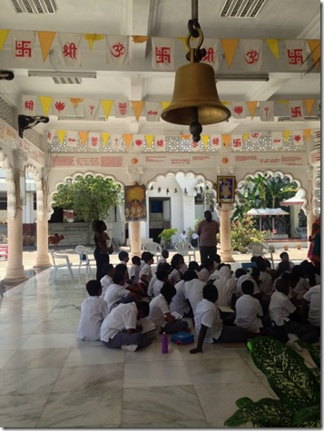 Tour guide at Shiv Temple describes various Hindu festivities to the students