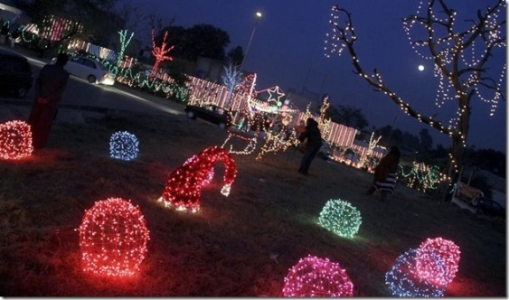 ISLAMABAD: An illumined view Christian locality site decorated with colorful light on the eve of Christmas celebrations at G-6. INP PHOTO by Sulaman Choudhry