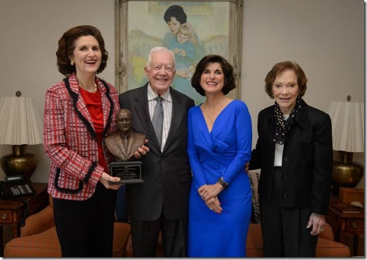 President and Mrs. Carter pose with former U.S. President Lyndon B. Johnson's daughters, Lynda Johnson Robb (left) and Luci Baines Johnson (right).
