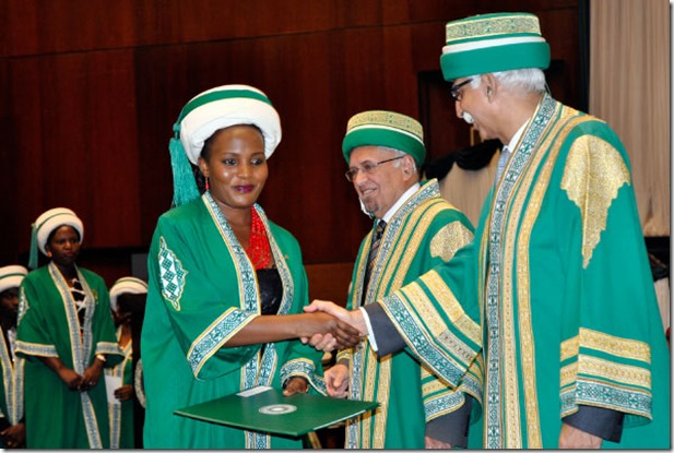Mr Firoz Rasul (R), the President of Aga Khan University, congratulates graduates during the university's convocation ceremony at Kampala Serena Conference Centre