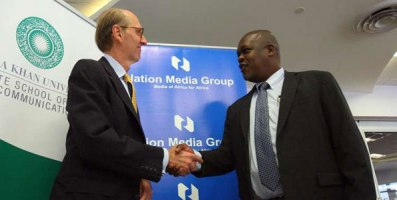 Nation Media Group chief executive Joe Muganda shakes hands with Michael Meyer, the Dean of Aga Khan University Graduate School of Media and Communications,