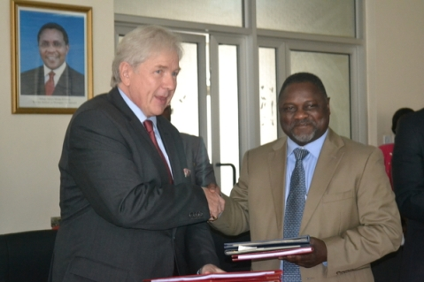 German Ambassador Kochanke with a Tanzanian counterpart at the signing ceremony