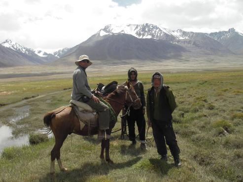 Karim-Aly Kassam riding to meet Kyrgyz pastoralists in the Pamir Mountains of Afghanistan near the border of China and Tajikistan.