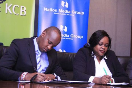 NMG general manager TV, Linus Kaikai (left) with KCB director, marketing and communications Angela Mwirigi on April 26, 2016 during the signing of a co-operation between KCB, Quite Bright Films Kenya (QBF),
