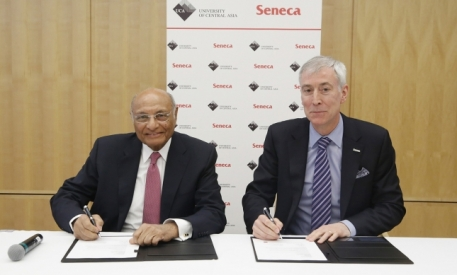 Shamsh Kassim-Lakha and David Agnew representing the University of Central Asia and Seneca College respectfully, reaffirm their partnership with a signing ceremony in Ottawa