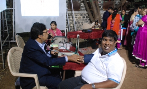 blood pressure checked at a Health Mantra event, India