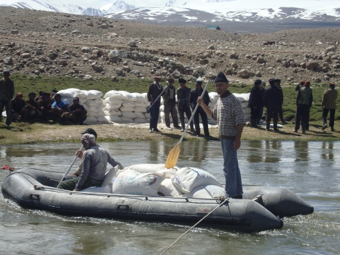 Food aid transported across the Panj River from Tajikistan for distribution in Afghanistan