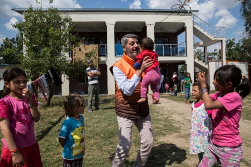 Levent Topçu plays with young Syrian refugees at the accommodation he provided for them, in Torbali, Turkey.