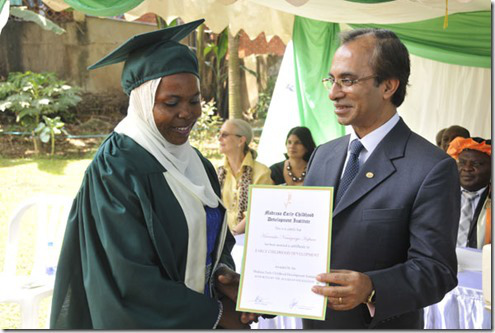 ms-hafiswa-namuyanja-kiwanuka-l-receives-a-certificate-from-his-ambassador-mahmood-ahmed_thumb
