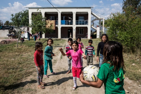 Young Syrian refugees play outside their accommodation provided by Levent Topçu,
