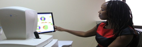 Dr Sheila Marco uses an Ocular Computerized Topography (OCT) machine to examine a patients ey