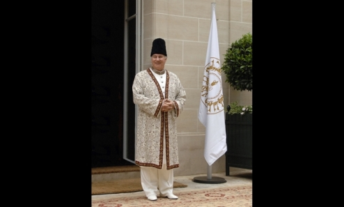 Mawlana Hazar Imam wearing ceremonial regalia outside his residence as he greets the leaders of the global Ismaili Muslim community. GARY OTTE