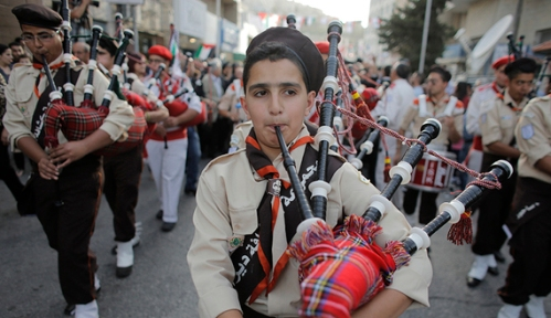 Scouts perform during a visit by Maronite Patriarch Beshara al-Rai to the West Bank town of Bethlehem May 27, 2014. Rai joined Pope Francis on his tour of the Holy Land this week, drawing criticism in Lebanon which remains in a formal state of war with its southern neighbor Israel. REUTERS/Ammar Awad (WEST BANK - Tags: RELIGION POLITICS) - RTR3R47Z