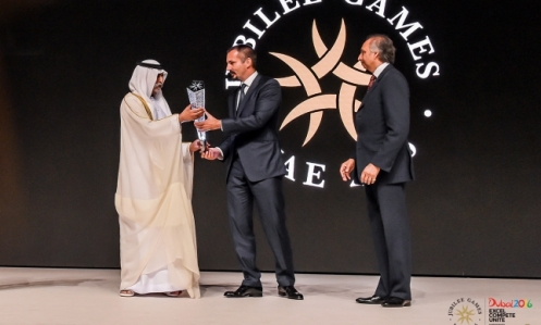 Prince Rahim presents Sheikh Nahyan with a momento of the 2016 Jubilee Games during the opening ceremony, as LIF Chairman Mahmoud Eboo looks on