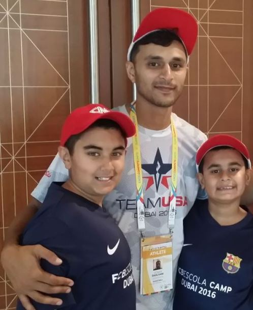 Adnan Dahlvani of Team USA with brothers Qayl (left) and Riyaan (right), both wearing the FC Barcelona soccer camp jerseys.