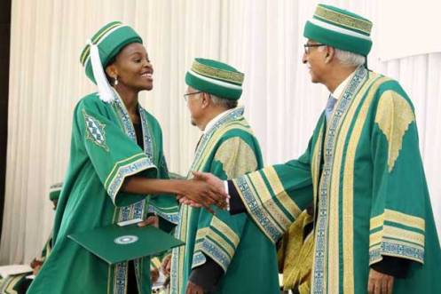 Aga Khan University President Firoz Rasul (right) congratulates a student during a graduation ceremony in February 2016