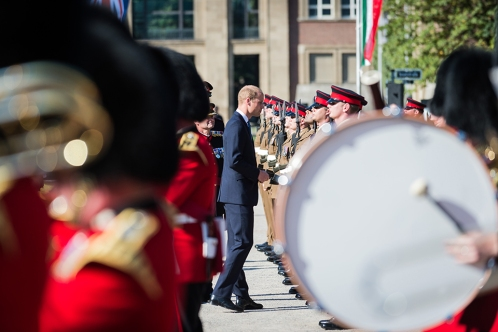 "The Duke of Cambridge visited Düsseldorf on Tuesday 23rd August to attend a series of events honouring the role of the British Forces in Germany, and celebrating the 70th anniversary of the state of North Rhine-Westphalia (NRW). During the visit, His Royal Highness saw a military parade with NRW Minister President Hannelore Kraft, met BFG personnel at a reception, and attend a 70th anniversary gala alongside Chancellor Angela Merkel. The events of the 23rd August in Düsseldorf will celebrate both the historic and current ties between NRW and Britain. To commemorate Britain's military contribution, The Duke will see NRW Minister President Hannelore Kraft present the Fahnenband, the Federal state's highest military honour, to 20th Armoured Infantry Brigade, in acknowledgment of their service to the defence of Germany. Following the parade, His Royal Highness will attend a reception in Düsseldorf's NRW Forum, where he'll meet members of the Brigade and their families. The soldiers on Parade forming the Honour Guard are from the 1st Battalion Princess of Wales's Royal Regiment based in Barker Barracks Paderborn. The Pennant Party comprises two Officers and two SNCOs from Headquarters 20 Armoured Infantry Brigade. The musical accompaniment is being provided by the Band of the Grenadier Guards. Photographer; Mr Dominic King Army Press Office Germany Info; NRW was established on 23rd August 1946 by the British Military Government, following the end of the Second World War, ""Operation Marriage"" merged the regions of North Rhine and Westphalia together. For almost 70 years, a large British military presence has remained in the region – known as British Forces Germany – playing a vital role during the Cold War and in the reconstruction of its area of occupation. The strong links between NRW and Britain remain today, with approximately 27,000 British citizens living in the state, and 345 British firms basing their companies here. The end of Second Worl"