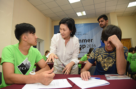 English faculty Dr Roza Kazakbaeva teaching English at the Second UCA Summer Camp.
