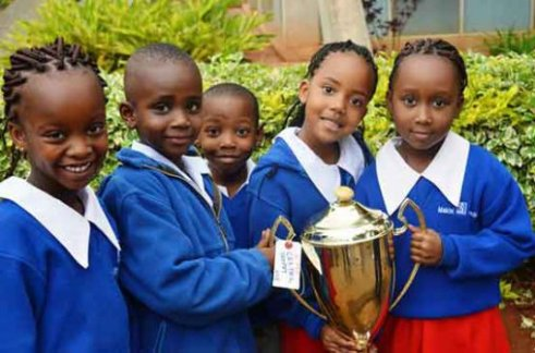Makini School pupils display their trophy after winning the setpiece class.