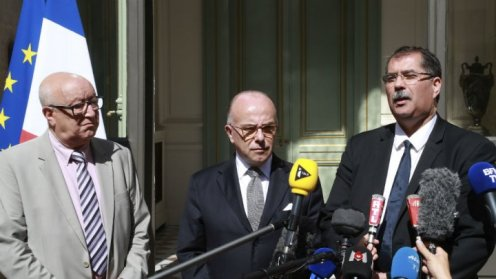 The head of France's top Muslim body Anouar Kbibech (right) speaks to journalists alongside his deputy Abdallah Zekri and Interior Minister Bernard Cazeneuve in Paris