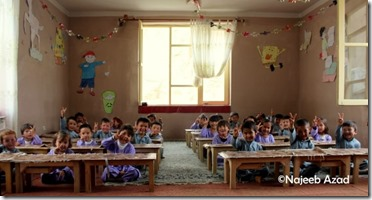 Afghan children cheering for peace. Photo by Najeeb Azad.