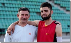 Tajik athlete Romikhudo Dodikhudoev with his trainer, Gairat Negmatov. MUBORAKSHO GULJONOV
