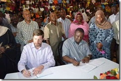 Aga Khan Foundation CEO Kevin Moorhead (seated left) and Kwale Governor Salim Mvurya signing an MoU to improve capacity of early childhood programs in the county on October 5, 2016