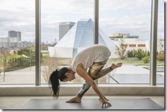 Yoga instructor YuMee Chung demonstrates a daring Pyramid Pose at the Aga Khan Museum.(ANNE-MARIE JACKSON)