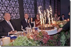 Members of Hazar Imam's family applaud as the birthday cake is presented to Mawlana Hazar Imam. ZAHUR RAMJI