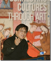 Museum director Henry S. Kim delivers a presentation on Friday