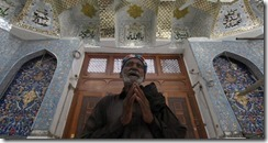 A devotee prays at the tomb of Sufi saint Lal Shahbaz Qalandar in Pakistan. Akhtar Soomro-Reuters