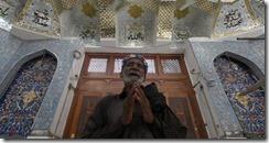 A devotee prays at the tomb of Sufi saint Lal Shahbaz Qalandar in Pakistan. Akhtar Soomro-Reuters