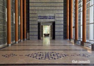 he social hall portal entrance at the Ismaili Jamatkhana and Centre, Khorog. The geometric Kufic script above the portal reads -Al-hamdu lillahi rabil 'alamin.