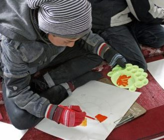 Young participant paining his ideas at the Winter Arts Camp