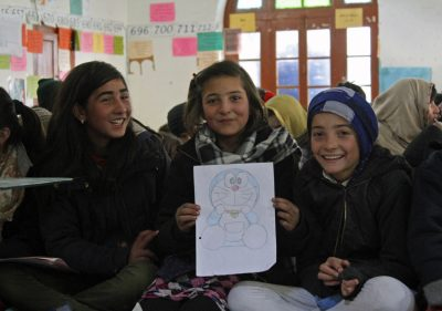 Young participants display their artwork at the Winter Arts Camp