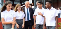 President Marcelo Rebelo de Sousa interacts with students during a visit to the Aga Khan Academy in Maputo. PHOTO: OTTO EVANDSON / AKDN